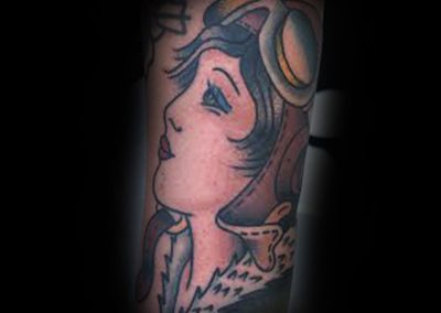 American Traditional Amelia Earhart Tattoo by Chris