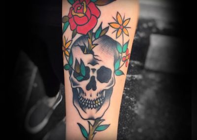 Traditional Skull and Rose Tattoo